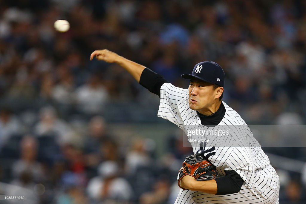 Masahiro Tanaka #19 of the New York Yankees pitches in the fifth inning against the Toronto Blue Jays at Yankee Stadium on September 14, 2018 in the Bronx borough of New York City. New York Yankees defeated the Toronto Blue Jays 11-0.