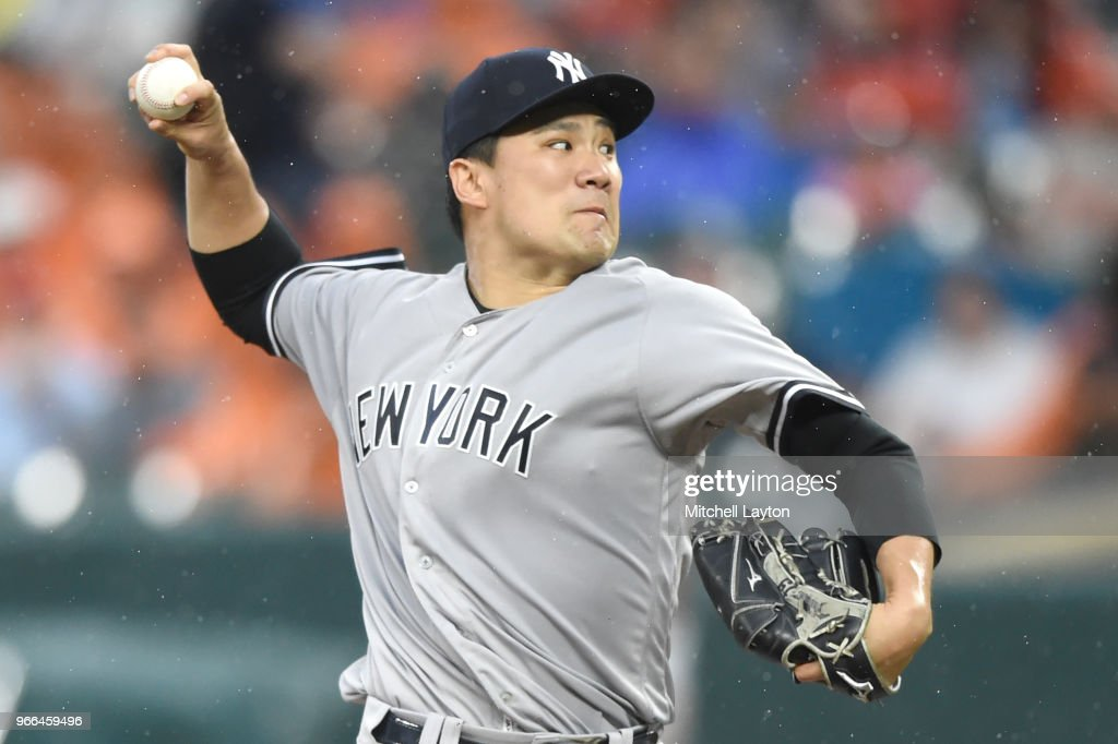 Masahiro Tanaka #19 of the New York Yankees pitches in the fifth inning during a baseball game against the Baltimore Orioles at Oriole Park at Camden Yards on June 2, 2018 in Baltimore, Maryland.