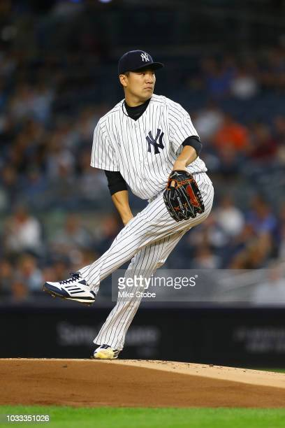 Masahiro Tanaka of the New York Yankees pitches in the first inning against the Toronto Blue Jays at Yankee Stadium on September 14 2018 in the Bronx...