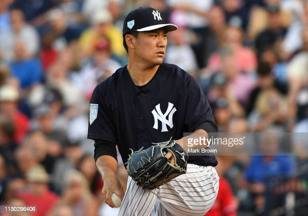 Masahiro Tanaka of the New York Yankees pitches in the first inning during the spring training game against the Philadelphia Phillies at Steinbrenner...
