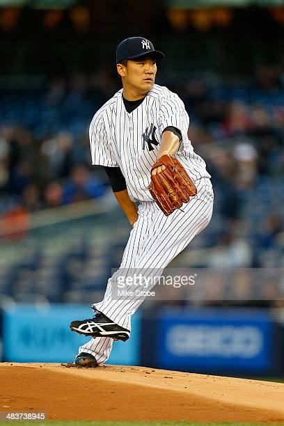 Masahiro Tanaka of the New York Yankees pitches in the first inning against the Baltimore Orioles at Yankee Stadium on April 9 2014 in the Bronx...