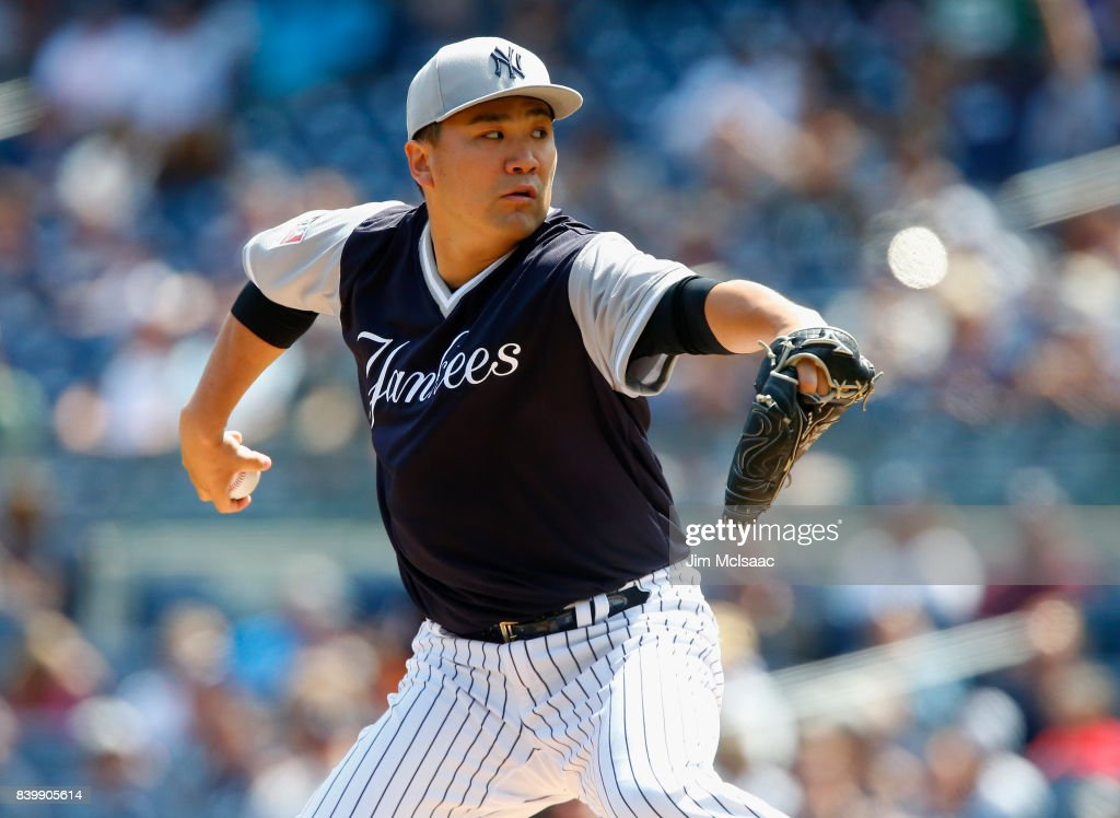 Masahiro Tanaka #19 of the New York Yankees pitches in the first inning against the Seattle Mariners at Yankee Stadium on August 27, 2017 in the Bronx borough of New York City.