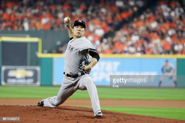Masahiro Tanaka of the New York Yankees pitches in the first inning against the Houston Astros during game one of the American League Championship...