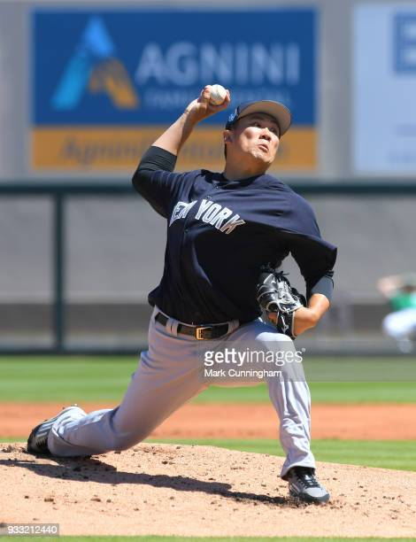 Masahiro Tanaka of the New York Yankees pitches in the first inning of the Spring Training game against the Detroit Tigers at Publix Field at Joker...