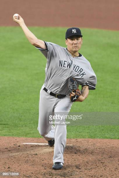 Masahiro Tanaka of the New York Yankees pitches in the forth inning during a baseball game against the Baltimore Orioles at Oriole Park at Camden...