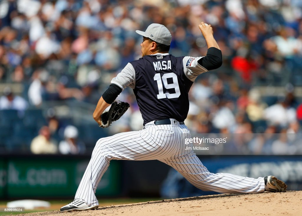 Masahiro Tanaka #19 of the New York Yankees pitches in the fourth inning against the Seattle Mariners at Yankee Stadium on August 27, 2017 in the Bronx borough of New York City. The Yankees defeated the Mariners 10-1.
