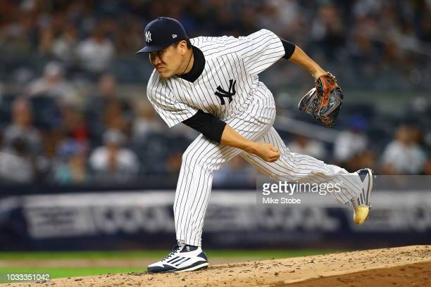 Masahiro Tanaka of the New York Yankees pitches in the second inning against the Toronto Blue Jays at Yankee Stadium on September 14 2018 in the...