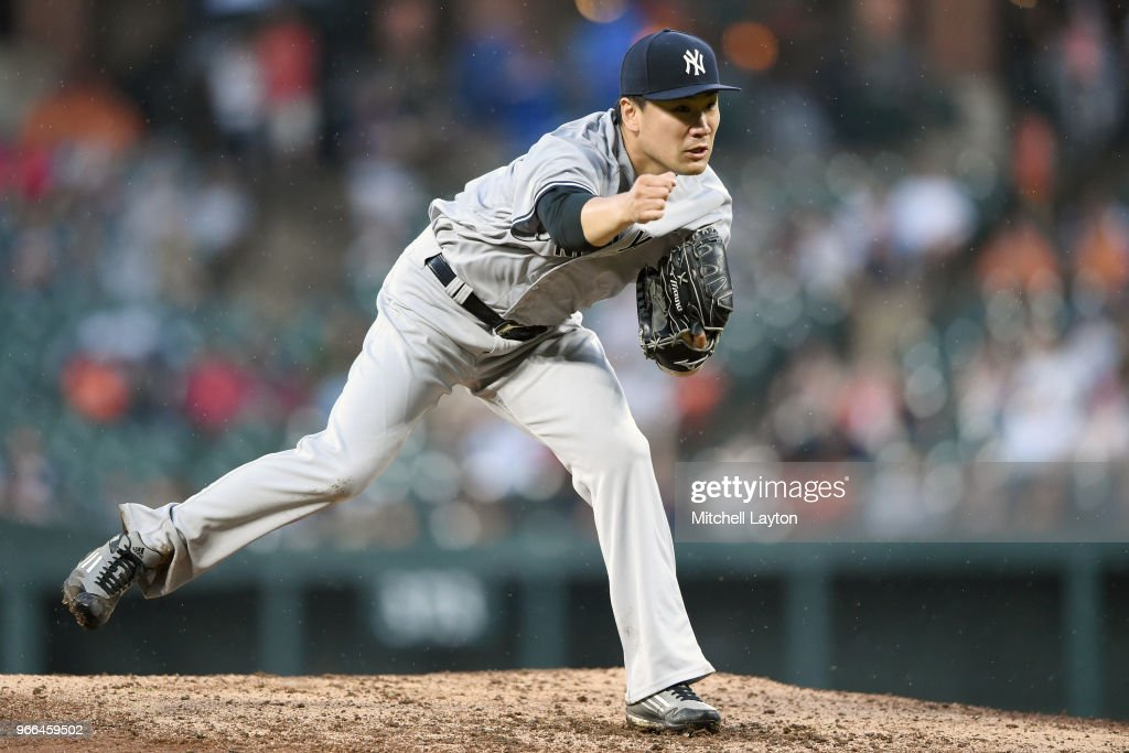 Masahiro Tanaka #19 of the New York Yankees pitches in the sixth inning during a baseball game against the Baltimore Orioles at Oriole Park at Camden Yards on June 2, 2018 in Baltimore, Maryland.