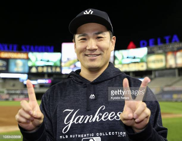 Masahiro Tanaka of the New York Yankees poses after picking up his 12th win for the season in a game against the Toronto Blue Jays in New York on...