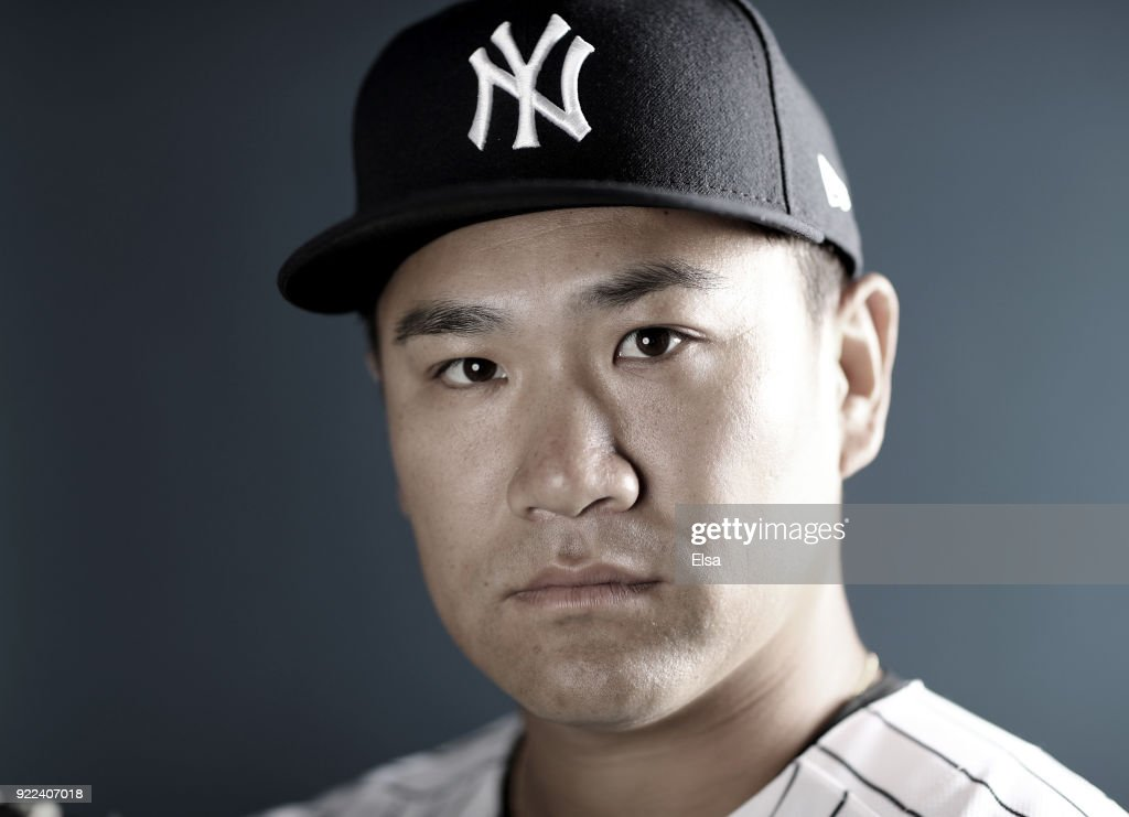 Masahiro Tanaka #19 of the New York Yankees poses for a portrait during the New York Yankees photo day on February 21, 2018 at George M. Steinbrenner Field in Tampa, Florida.