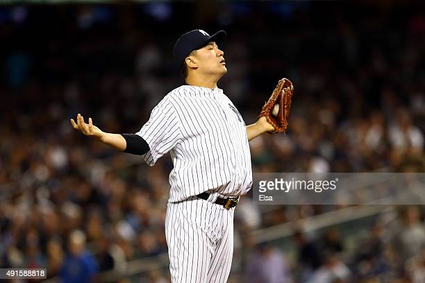 Masahiro Tanaka of the New York Yankees reacts after a pitch in the second inning against the Houston Astros during the American League Wild Card...