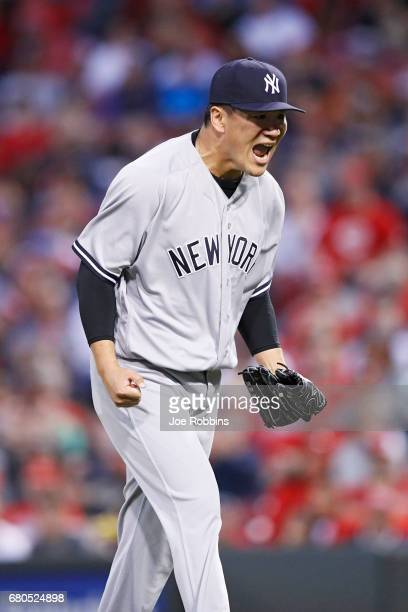 Masahiro Tanaka of the New York Yankees reacts after getting a double play with the bases loaded to end the first inning of a game against the...