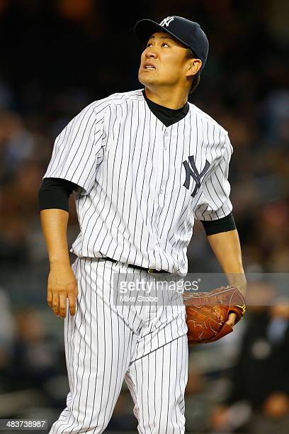 Masahiro Tanaka of the New York Yankees reacts after giving up a threerun home run to Jonathan Schoop of the Baltimore Orioles in the second inning...