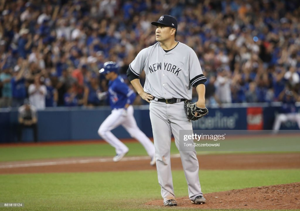 Masahiro Tanaka #19 of the New York Yankees reacts after giving up a grand slam home run to Ryan Goins #17 of the Toronto Blue Jays in the sixth inning during MLB game action against the Toronto Blue Jays at Rogers Centre on September 22, 2017 in Toronto, Canada.