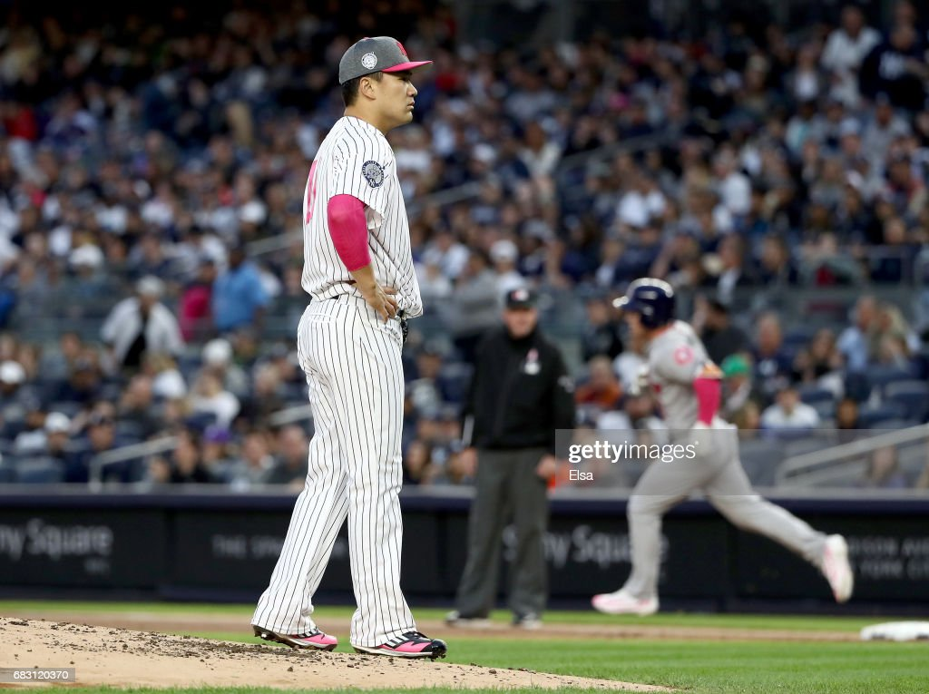 Masahiro Tanaka #19 of the New York Yankees reacts after giving up a grand slam to Alex Bregman #2 of the Houston Astros in the first inning in Game 2 on May 14, 2017 at Yankee Stadium in the Bronx borough of New York City.