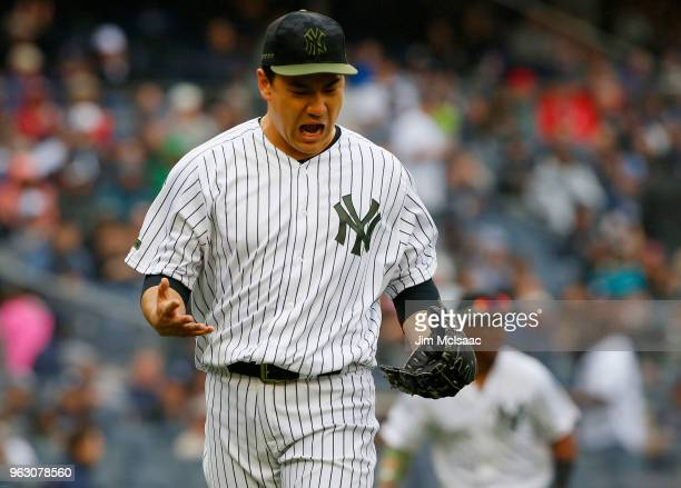 Masahiro Tanaka of the New York Yankees reacts as he walks to the dugout after a fourth inning ending double play against the Los Angeles Angels of...