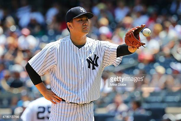 Masahiro Tanaka of the New York Yankees reacts in the first inning against the Detroit Tigers at Yankee Stadium on June 21 2015 in the Bronx borough...