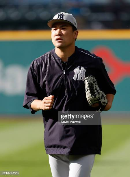 Masahiro Tanaka of the New York Yankees returns from the outfield after batting practice before the start of the game against the Cleveland Indians...