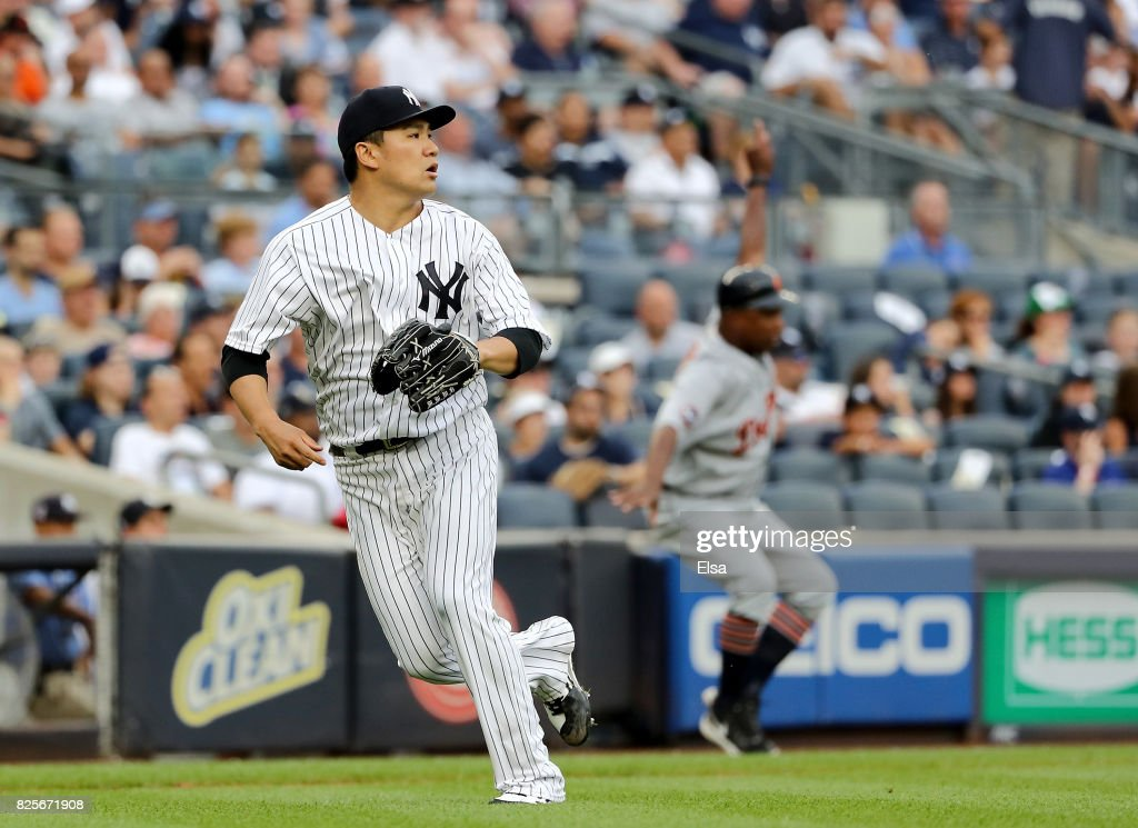 Masahiro Tanaka #19 of the New York Yankees runs to cover home after teammate Jacoby Ellsbury commits an error on a hit by James McCann of the Detroit Tigers in the fourth inning on August 2, 2017 at Yankee Stadium in the Bronx borough of New York City.
