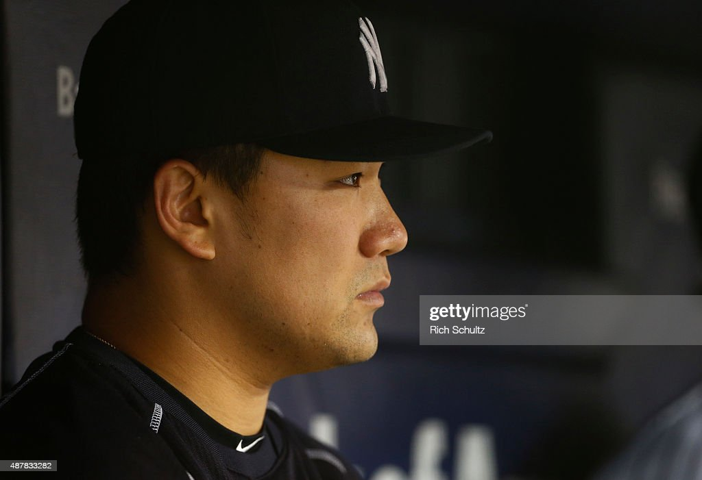 Masahiro Tanaka #19 of the New York Yankees sits in the dugout during the seventh inning during a MLB baseball game against the Toronto Blue Jays at Yankee Stadium on September 11, 2015 in the Bronx borough of New York City.