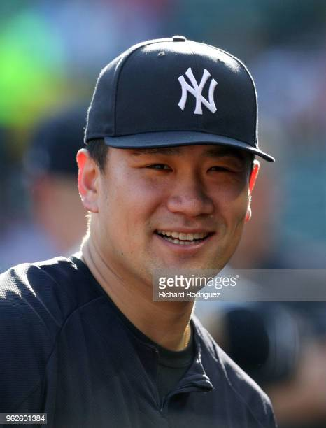 Masahiro Tanaka of the New York Yankees stands in the dugout before the baseball game against the Texas Rangers at Globe Life Park in Arlington on...