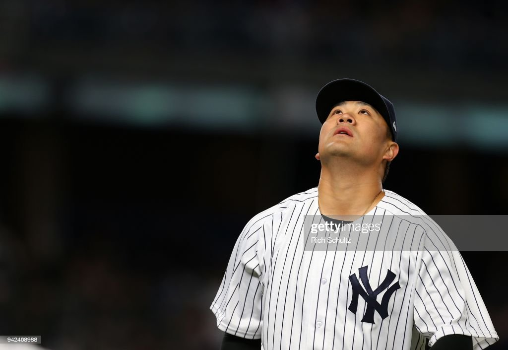 Masahiro Tanaka #19 of the New York Yankees stares up after being relieved in the seventh inning of a game against the Baltimore Orioles at Yankee Stadium on April 5, 2018 in the Bronx borough of New York City.