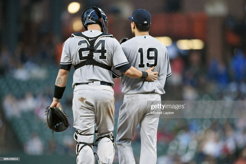Masahiro Tanaka #19 of the New York Yankees talks with Gary Sanchez #24 in the sixth inning during a baseball game against the Baltimore Orioles at Oriole Park at Camden Yards on June 2, 2018 in Baltimore, Maryland.