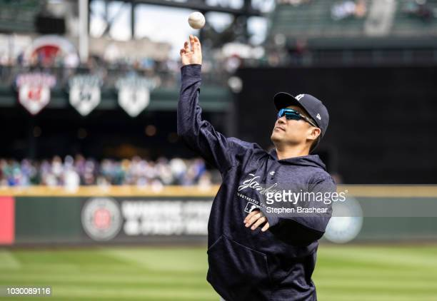 Masahiro Tanaka of the New York Yankees throws a ball to a fan before a game against the Seattle Mariners at Safeco Field on September 9 2018 in...
