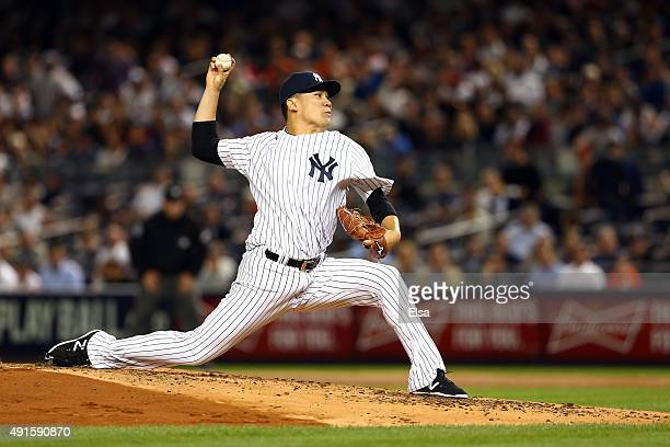 Masahiro Tanaka of the New York Yankees throws a pitch against the Houston Astros during the American League Wild Card Game at Yankee Stadium on...