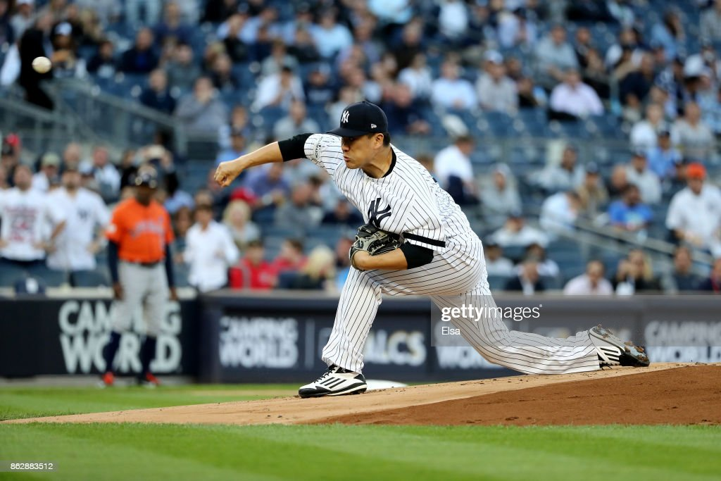 Masahiro Tanaka #19 of the New York Yankees throws a pitch against the Houston Astros during the first inning in Game Five of the American League Championship Series at Yankee Stadium on October 18, 2017 in the Bronx borough of New York City.