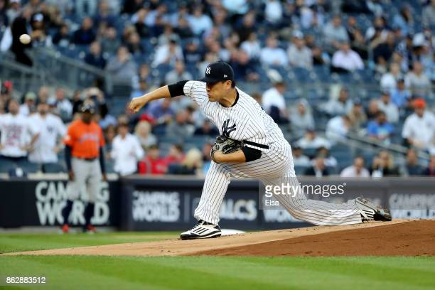 Masahiro Tanaka of the New York Yankees throws a pitch against the Houston Astros during the first inning in Game Five of the American League...