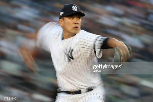 Masahiro Tanaka of the New York Yankees throws a pitch in game two of the American League Division Series against the Minnesota Twins at Yankee...