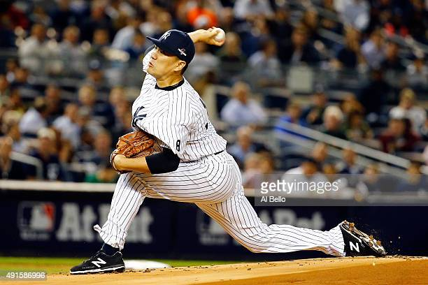 Masahiro Tanaka of the New York Yankees throws a pitch in the first inning against the Houston Astros during the American League Wild Card Game at...