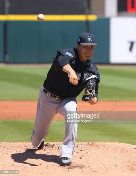 Masahiro Tanaka of the New York Yankees throws a warmup pitch in the first inning of the Spring Training game against the Detroit Tigers at Publix...