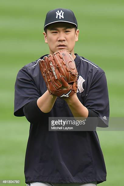 Masahiro Tanaka of the New York Yankees throws before a baseball game against the Baltimore Orioles at Oriole Park at Camden Yards on October 4 2015...