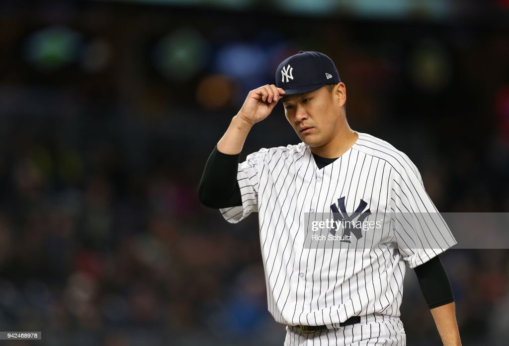 Masahiro Tanaka #19 of the New York Yankees tips his cap after being relieved in the seventh inning of a game against the Baltimore Orioles at Yankee Stadium on April 5, 2018 in the Bronx borough of New York City.