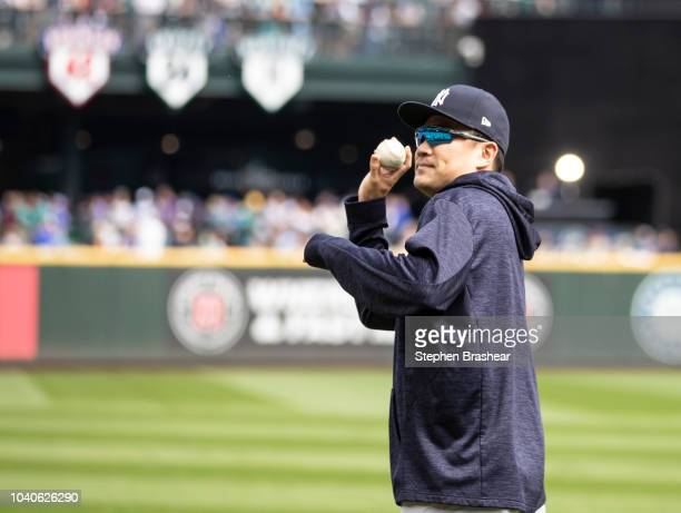 Masahiro Tanaka of the New York Yankees tosses a ball to fans before a game against the Seattle Mariners at Safeco Field on September 9 2018 in...