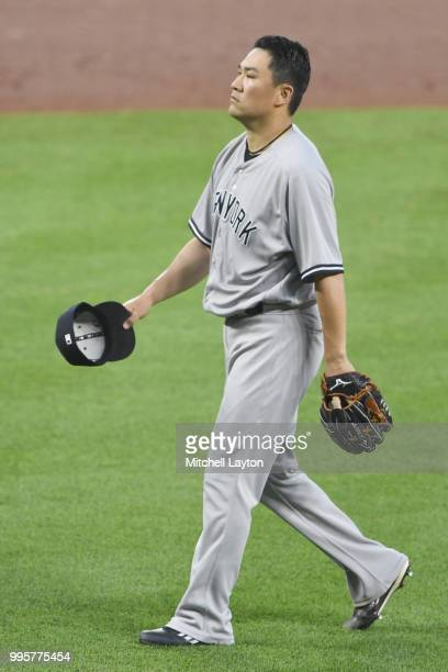 Masahiro Tanaka of the New York Yankees walks back to the dug out in the fifth inning during a baseball game against the Baltimore Orioles at Oriole...