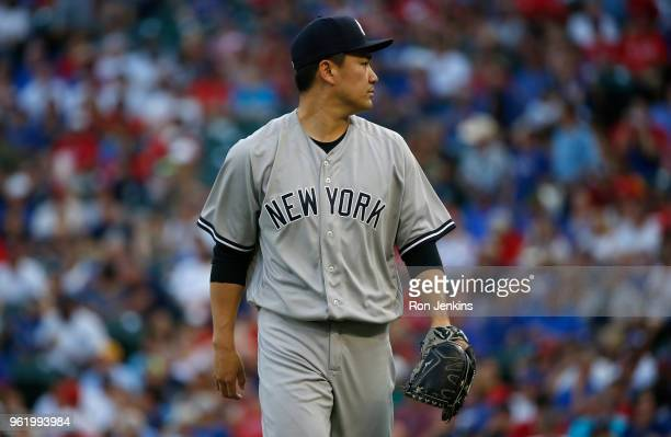 Masahiro Tanaka of the New York Yankees walks back to the dugout after pitching against the Texas Rangers at Globe Life Park on May 21 2018 in...