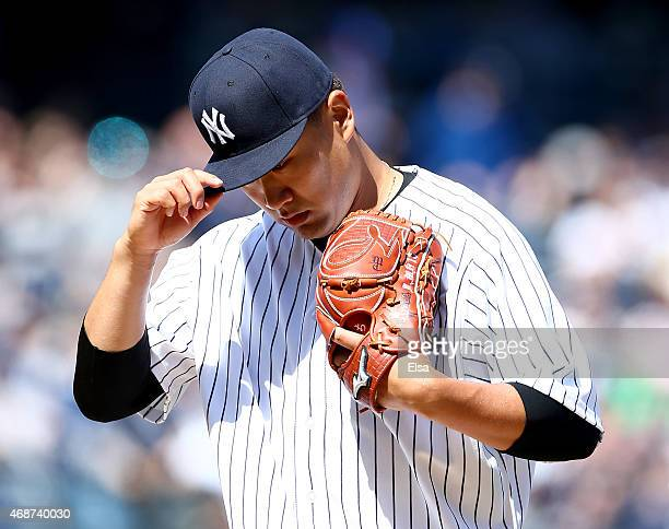 Masahiro Tanaka of the New York Yankees walks off the field after the first inning against the Toronto Blue Jays during Opening Day on April 6 2015...