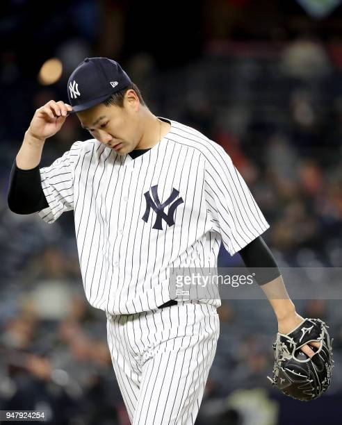 Masahiro Tanaka of the New York Yankees walks off the field after the fifth inning against the Miami Marlins at Yankee Stadium on April 17 2018 in...