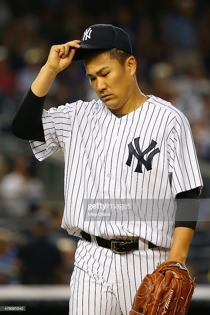 Masahiro Tanaka #19 of the New York Yankees walks off the mound after thr third out in the fifth inning against the Tampa Bay Rays at Yankee Stadium on July 3, 2015 in the Bronx borough of New York City.
