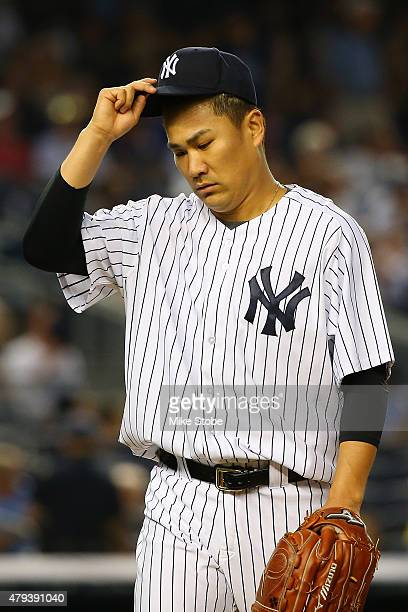 Masahiro Tanaka of the New York Yankees walks off the mound after thr third out in the fifth inning against the Tampa Bay Rays at Yankee Stadium on...