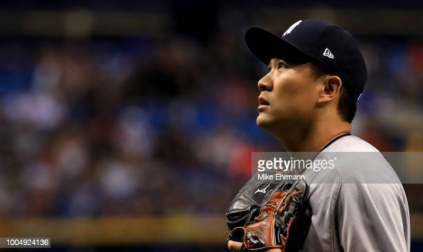 Masahiro Tanaka of the New York Yankees walks off the mound in the eighth inning during a game against the Tampa Bay Rays at Tropicana Field on July...