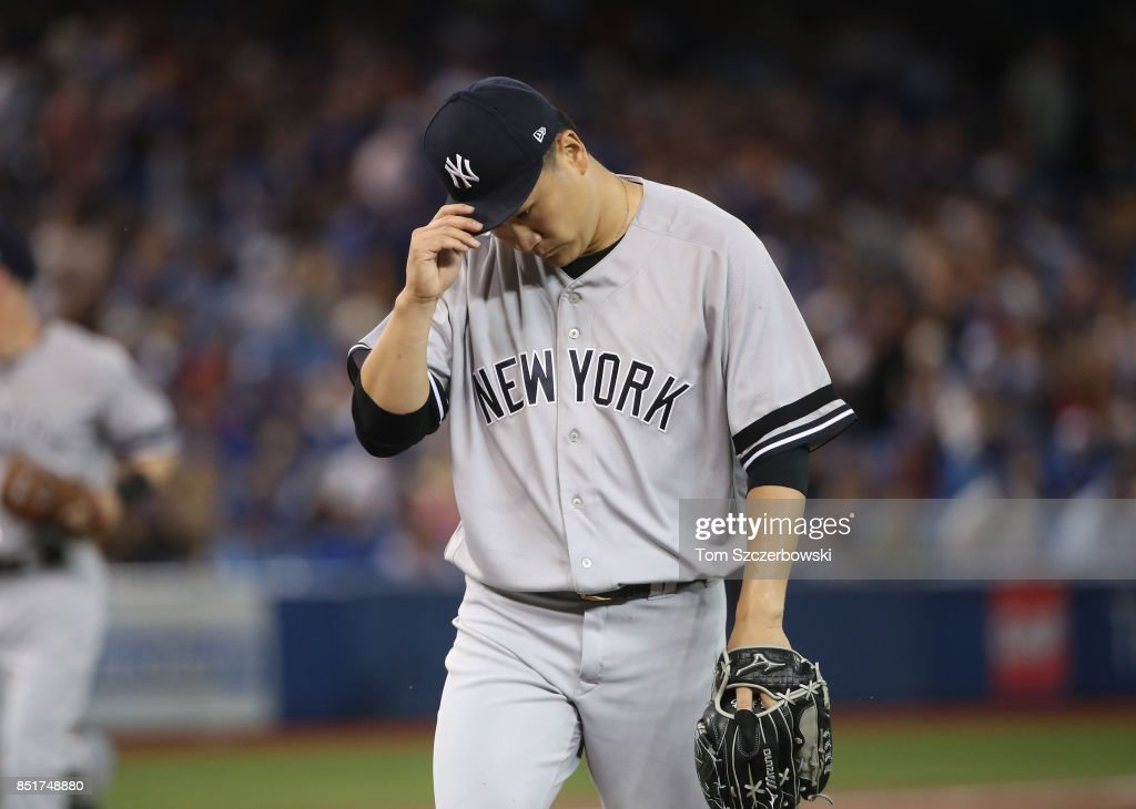 Masahiro Tanaka #19 of the New York Yankees walks off the mound in the direction of his dugout after giving up an unearned run in the first inning during MLB game action against the Toronto Blue Jays at Rogers Centre on September 22, 2017 in Toronto, Canada.
