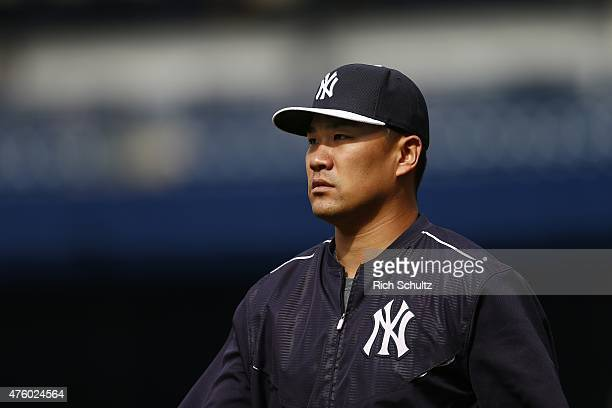 Masahiro Tanaka of the New York Yankees walks on the field prior to the start of a MLB baseball game against of the Los Angeles Angels of Anaheim at...