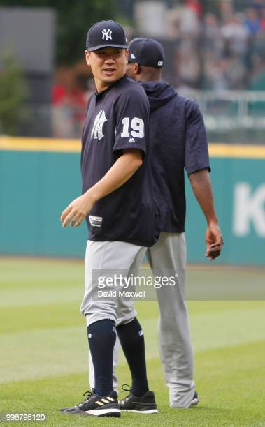 Masahiro Tanaka of the New York Yankees walks to the bullpen with teammates before the start of the game against the Cleveland Indians at Progressive...