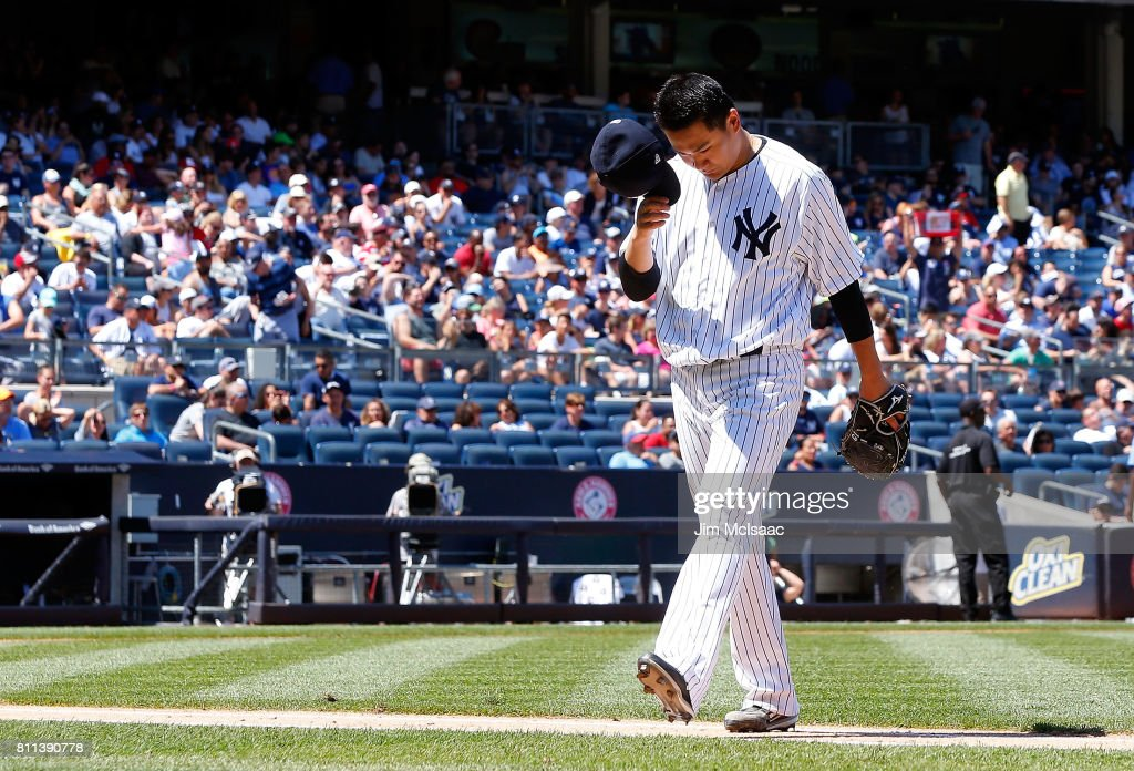Masahiro Tanaka #19 of the New York Yankees walks to the dugout after he was removed from a game against the Milwaukee Brewers during the fifth inning at Yankee Stadium on July 9, 2017 in the Bronx borough of New York City.