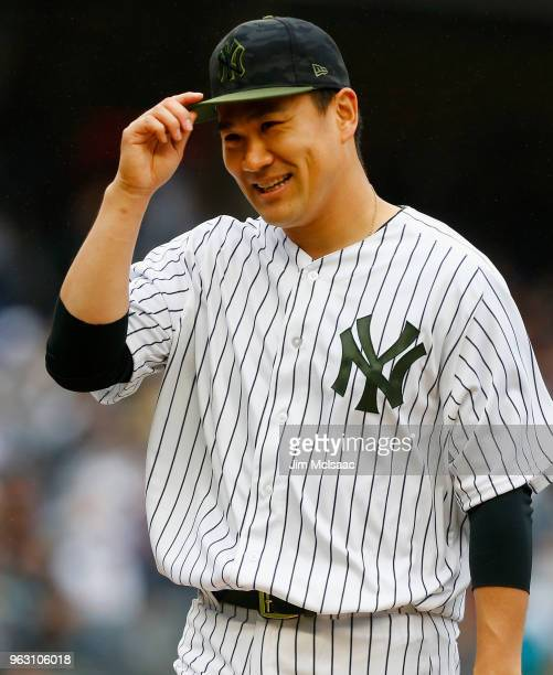 Masahiro Tanaka of the New York Yankees walks to the dugout after the fourth inning against the Los Angeles Angels of Anaheim at Yankee Stadium on...