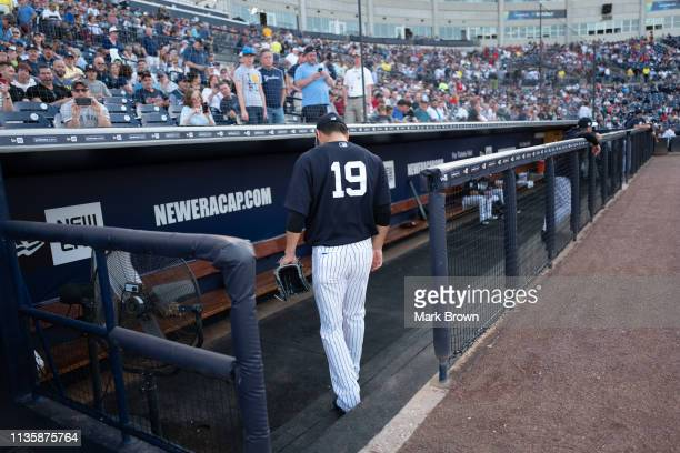 Masahiro Tanaka of the New York Yankees walks to the dugout from the bullpen before the spring training game against the Philadelphia Phillies at...